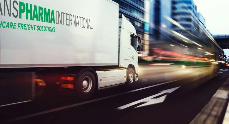 White,Truck,Moving,Fast,On,The,Road,In,A,Modern